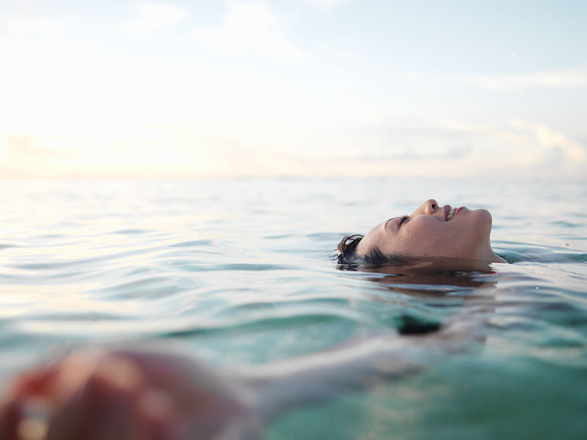 Woman smiling relaxing in water